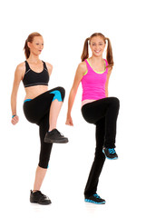 Two women doing zumba fitness