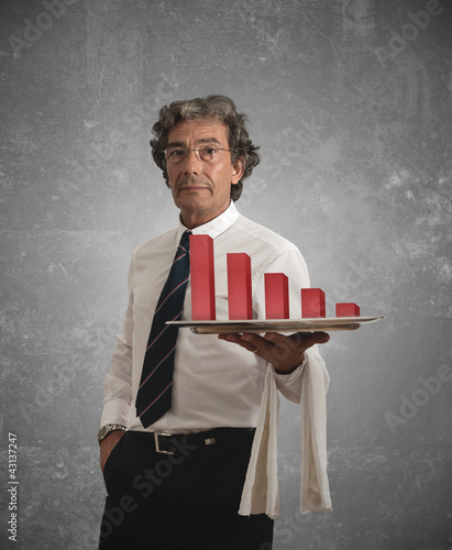 Businessman holds a tray with negative statistics