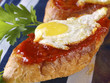 """Soft spicy sausage and quail eggs """"Montadito""""."""