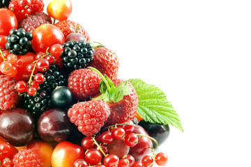 assortment of fresh berries and fruit on white background