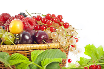 fresh berries and fruits in basket on white background