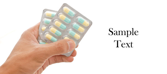 Hand Holding Antibiotic Medicine