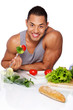 Portrait of muscle man posing in studio with food
