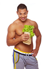 Portrait of handsome man posing on white background with salad