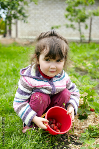 Girl of three years old with berries
