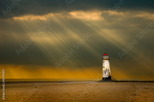 lighthouse as the storm breaks - 43143855