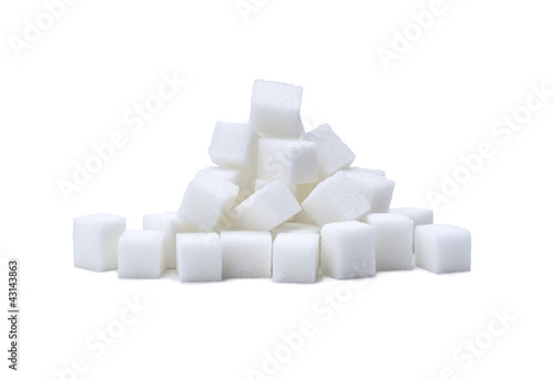 pile of refined white sugar cubes