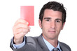 portrait of a man holding red card
