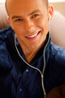 portrait of a young smiling nice man listening to music