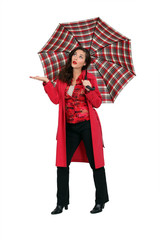 Woman in red with a tartan umbrella