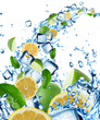 Fresh lemons and limes in water splash with ice cubes