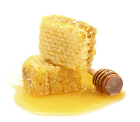 golden honeycombs with honey isolated on white.