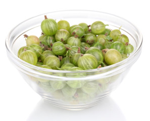 Green gooseberry in glass bowl isolated on white