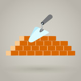 Trowel and brick wall vector icon building design