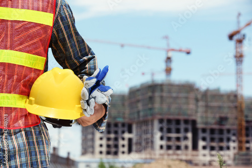 man holding yellow helmet