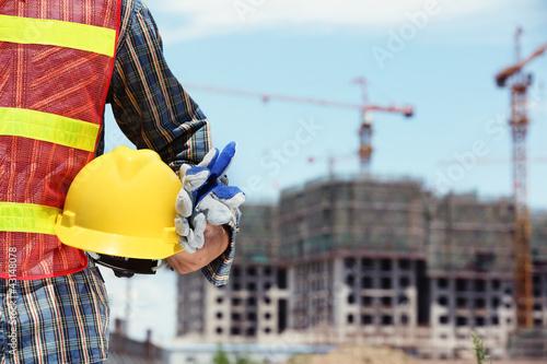 man holding yellow helmet
