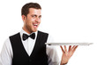 Smiling waiter holding an empty dish