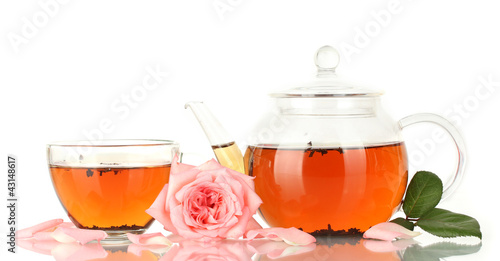 teapot and cup of tea with rose isolated on white