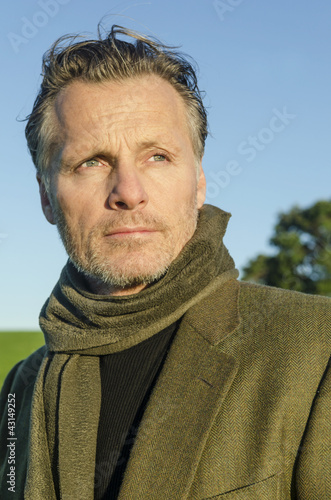 pensive looking mature man with beard