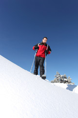 Male skier on a mountain