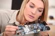 woman repairing pc