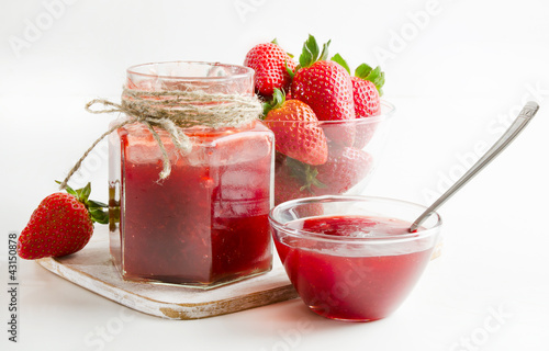strawberries marmalade on a wooden table