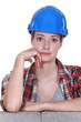 Wide eyed female construction worker