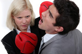 Woman executive punching her colleague.