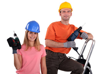 Man and woman with drills