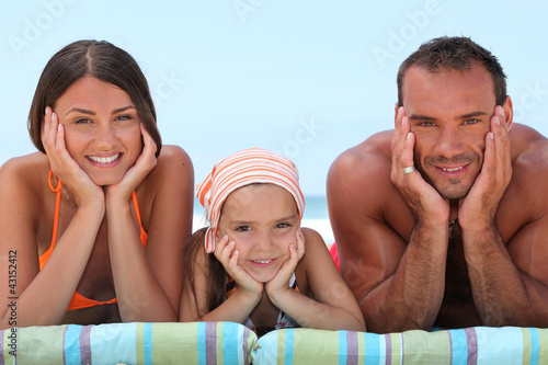 Portrait of a lovely family at the beach