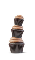three cupcakes isolated on white