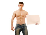 Nude muscular man covering with a copy space blank