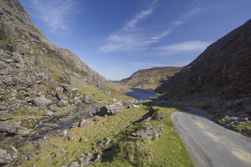 Mountain road leading into Gap of Dunloe vallery located in Kill