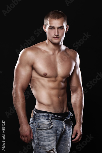 Young and sexy guy wearing jeans