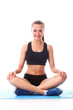 Smiling fitness girl sitting in standart yoga pose