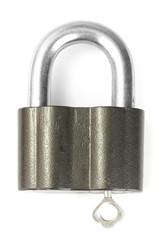 old padlock with key isolated on white background
