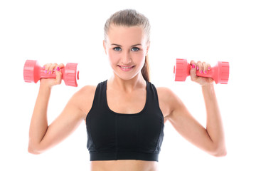 Happy woman doing exercises with dumbbells