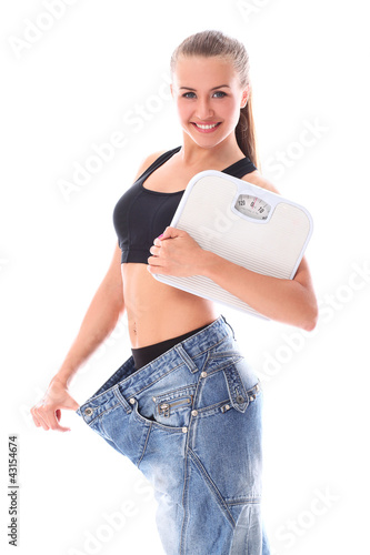 Woman wearing old jeans after weight loss