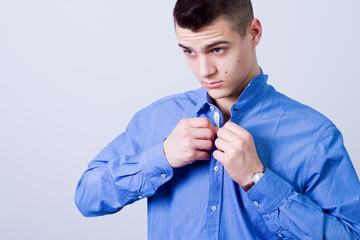 dressing up, handsome man button up his blue shirt