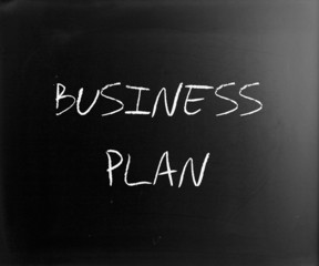 """Business plan"" handwritten with white chalk on a blackboard"