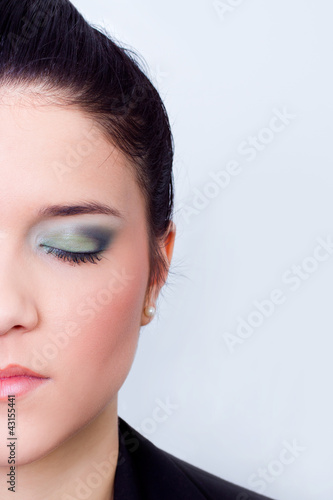 female eye with makeup