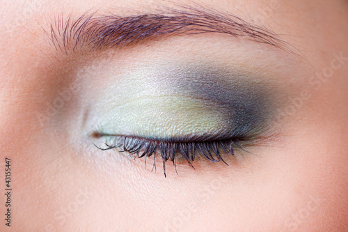 closeup female eye with makeup