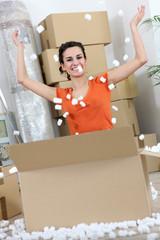 Happy woman celebrating new apartment