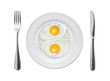 Fried eggs in the form of yin and yang on a plate.