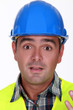 Builder with confused look on his face