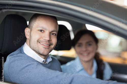 Happy man smiling in a car