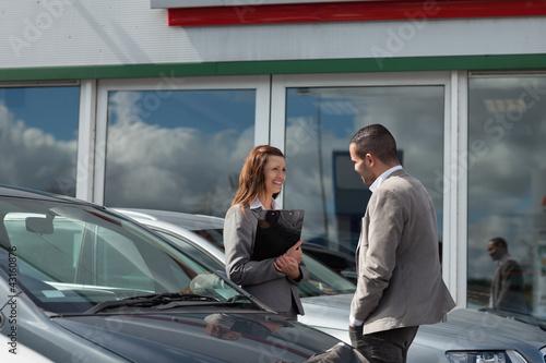Businesswoman speaking  to a man