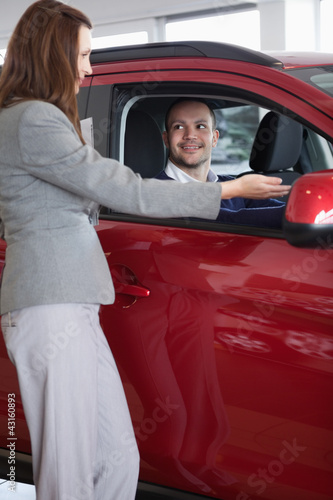 Businesswoman showing something to a man
