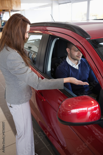 Woman presenting something to a client
