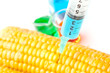 Syringe piercing corn